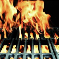 image of flames coming through on a barbeque